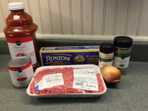 Ingredients for easy crockpot spaghetti with uncooked noodles