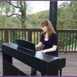 Playing piano at outdoor wedding