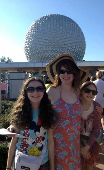 wearing sun hat at Epcot Disney park