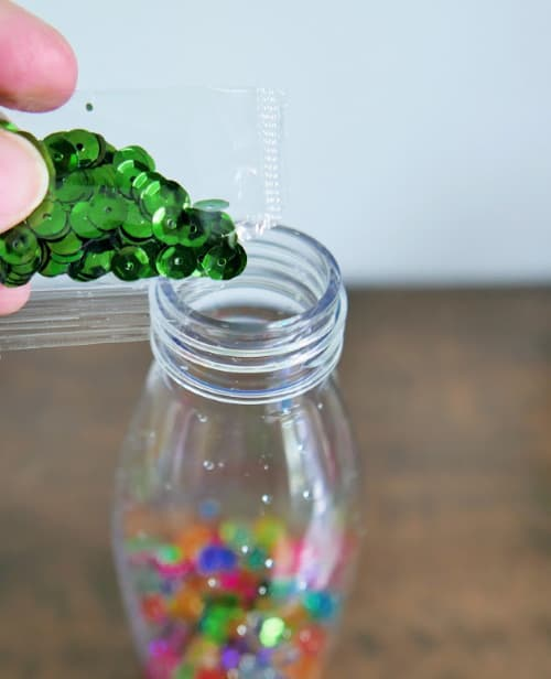 Add green sequins to bottle