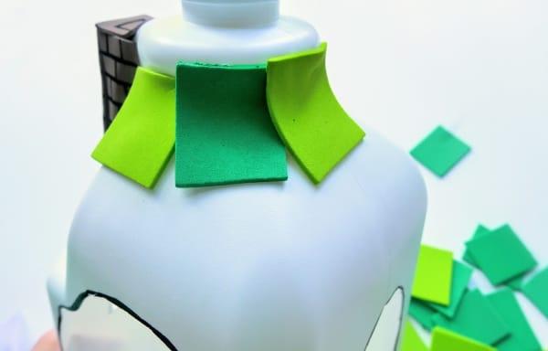 Alternating green squares on milk jug