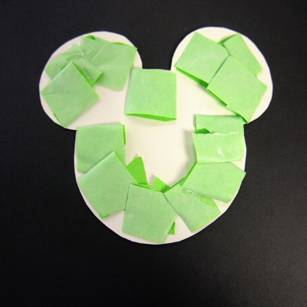 Attach tape to edges of  Mickey Mouse template