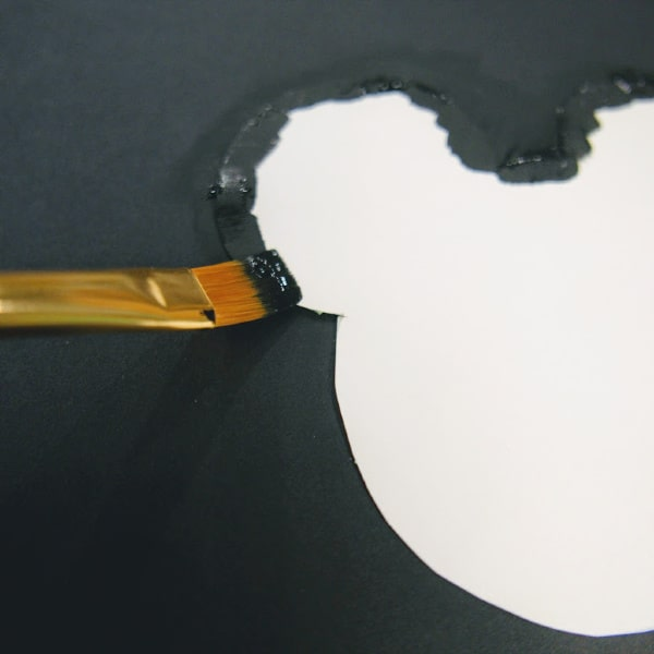 Black paint on edge of Mickey Mouse template