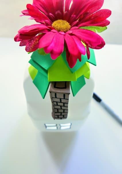 Flower on top of milk jug