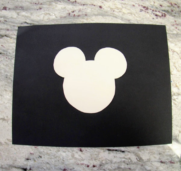 Mickey Mouse template against black cardstock