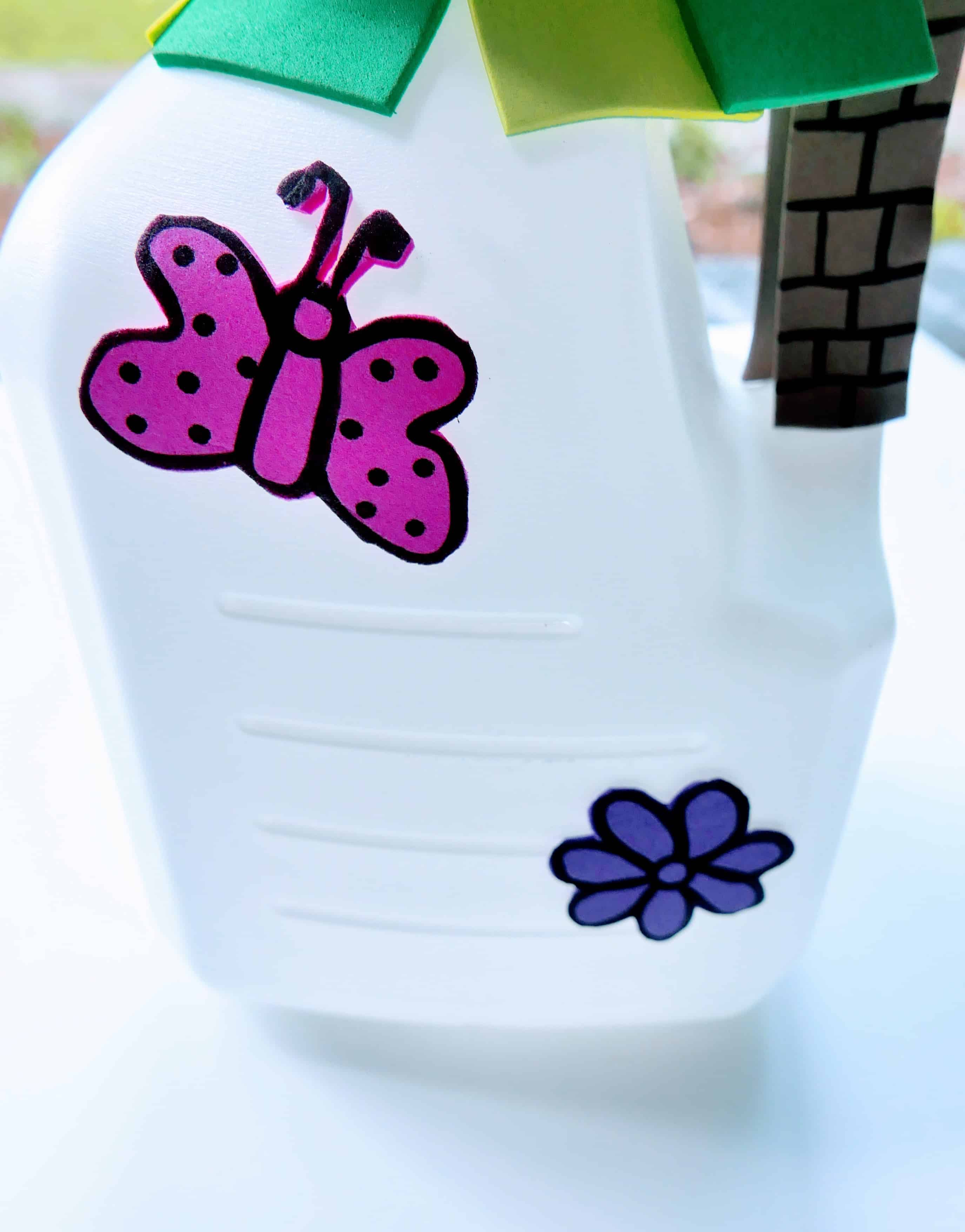 Milk jug with colorful decorations