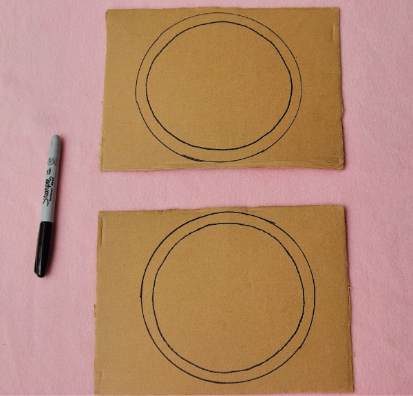 Sharpie and 2 concentric circles on cardboard