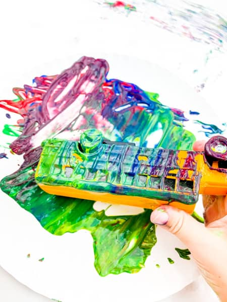 School bus on plate of paint