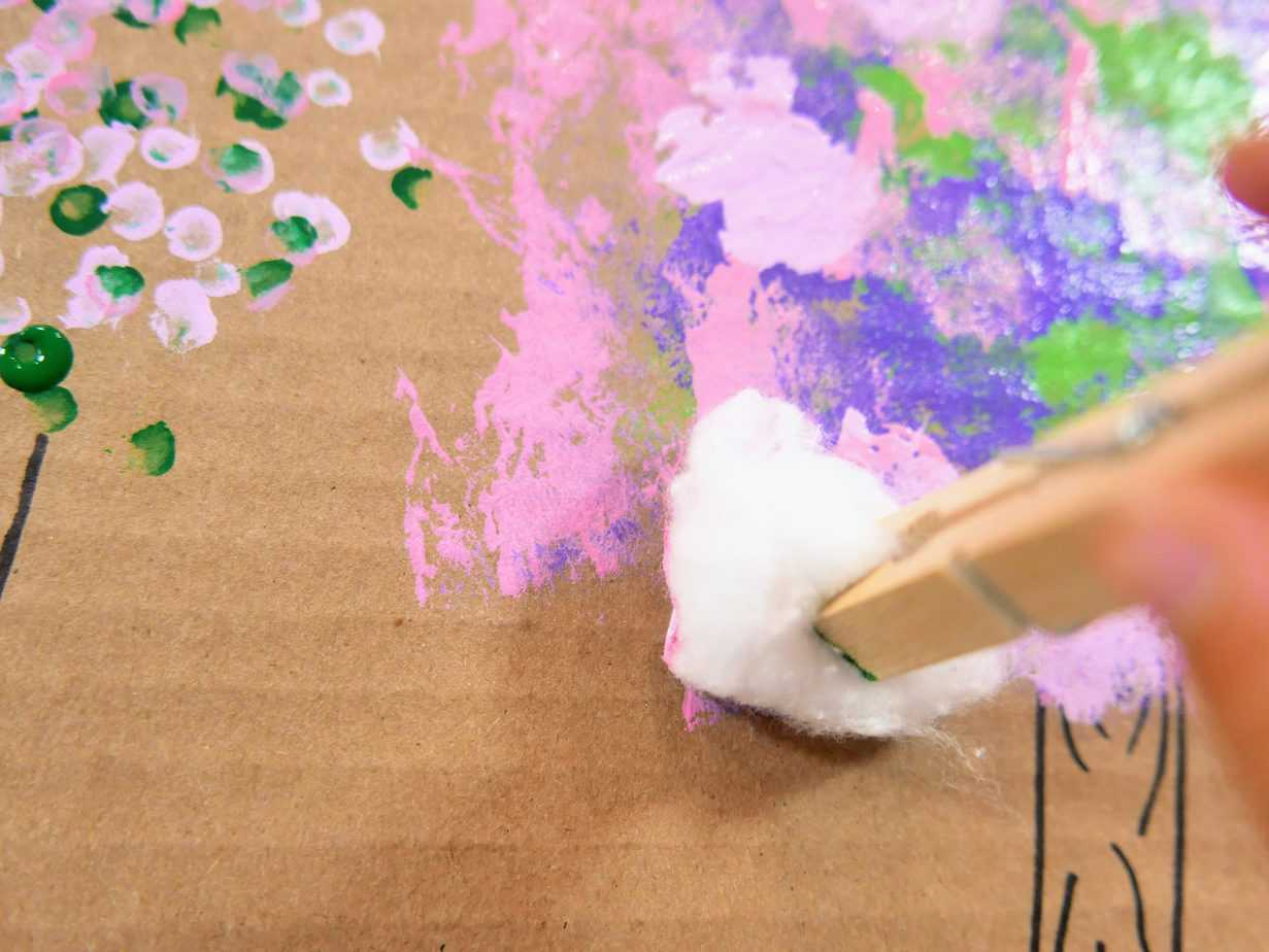 Dabbing cotton ball paint on tree