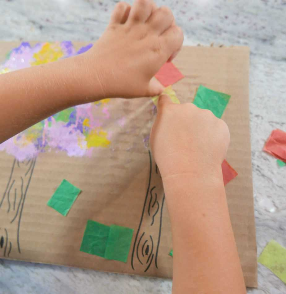 Gluing down colorful tissue squares