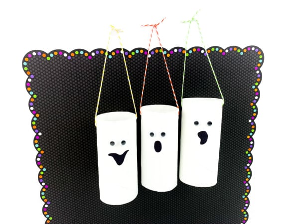 Hanging toilet paper roll ghosts