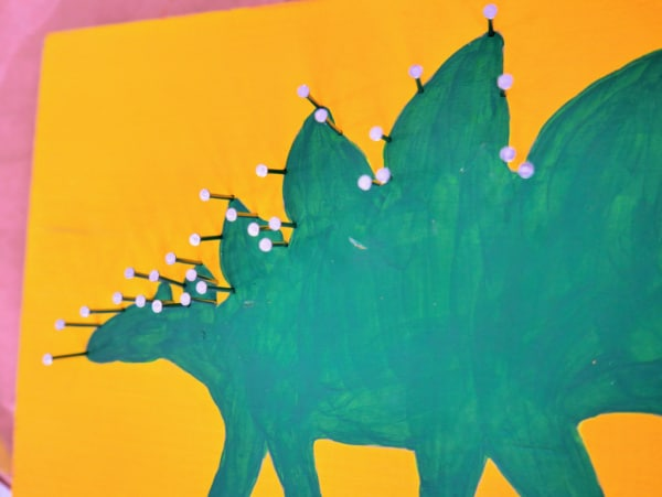 Adding nails to dinosaur spikes