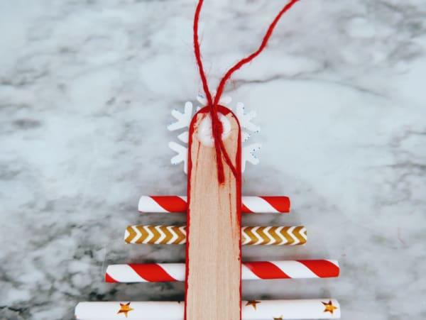 Glue twine to top of stick
