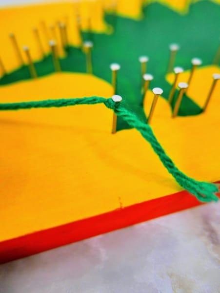 Green string on nail