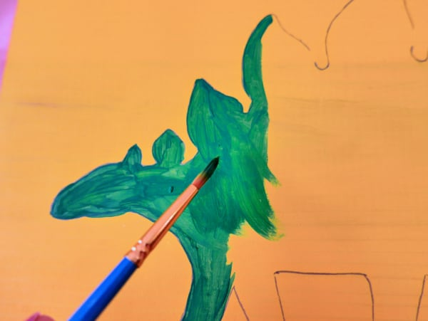 Painting dinosaur green