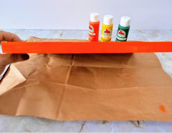 Painting edge of wood orange
