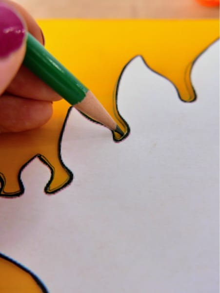 Trace dinosaur template with pencil
