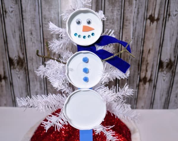 Finished snowman craft with upcycled lids
