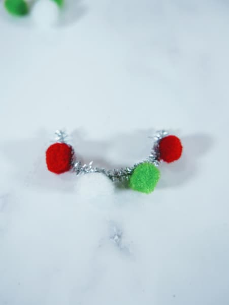 3 pompoms on pipe cleaner